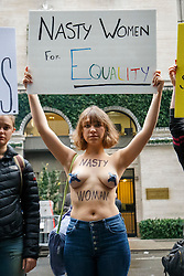 © Licensed to London News Pictures. 09/11/2016. New York CIty, USA. A topless anti-Trump campaigner protests outside Trump Tower in New York City, on Wednesday, 9 November 2016 following the presidential election won by Donald Trump. Photo credit: Tolga Akmen/LNP