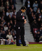 Photo: Leigh Quinnell.<br /> West Ham United v Fulham. The Barclays Premiership. 13/01/2007. Fulham manager Chris Coleman checks his watch.