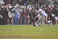 Mississippi State wide receiver Chad Bumphis (1) is tackled by Ole Miss' Ralph Williams (44) in Starkville, Miss. on Saturday, November 26, 2011.