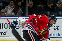 KELOWNA, CANADA - MARCH 3: Jake Gricius #14 of the Portland Winterhawks is checked after the face off against Kyle Topping #24 of the Kelowna Rockets  on March 3, 2019 at Prospera Place in Kelowna, British Columbia, Canada.  (Photo by Marissa Baecker/Shoot the Breeze)