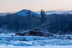 Dawn over the Saco River in New Hampshire's White Mountains. Winter. Mount Kearsarge is in the distance.