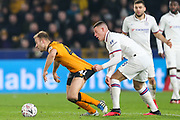Chelsea forward Tammy Abraham (9) pulls the shorts of Hull City midfielder Herbie Kane (41) during The FA Cup match between Hull City and Chelsea at the KCOM Stadium, Kingston upon Hull, England on 25 January 2020.