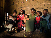 Kifene Tadesse, 38, and her family share their coffee and yams for lunch, Boreda, Ethiopia.