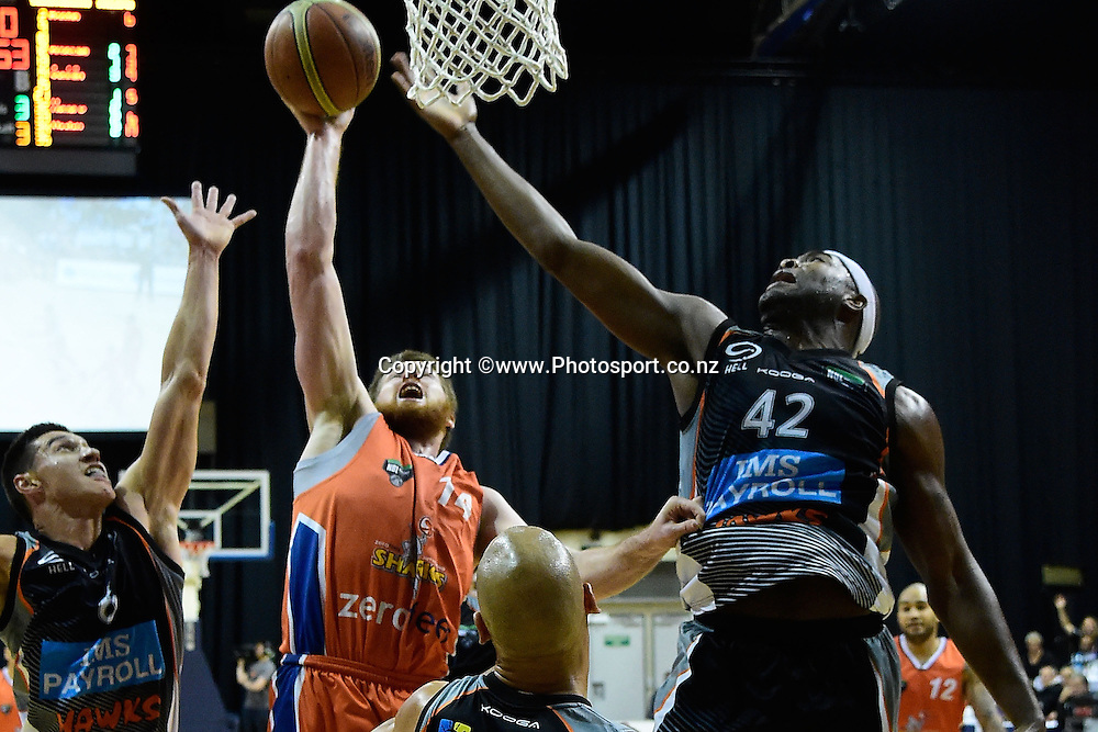 Brian Conklin (L) of the Sharks jumps to shoot with Kareem Johnson of the Hawks in defense during a NBL - Hawks vs Sharks semi final four basketball match at the TSB Arena in Wellington on Friday the 4th of July 2014. Photo by Marty Melville/www.Photosport.co.nz
