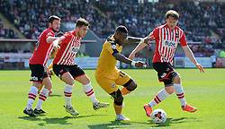 Newport County's Aaron O'Connor is tackled by Exeter City's Christian Riberio - Photo mandatory by-line: Harry Trump/JMP - Mobile: 07966 386802 - 06/04/15 - SPORT - FOOTBALL - Sky Bet League Two - Exeter City v Newport County - St James Park, Exeter, England.