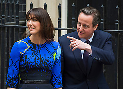 © London News Pictures. 08/05/2015. British prime minister DAVID CAMERON returns to Downing Street with his wife SAMANTHA CAMERON after visiting the Queen to formally form a majority government. .Photo credit: Ben Cawthra/LNP