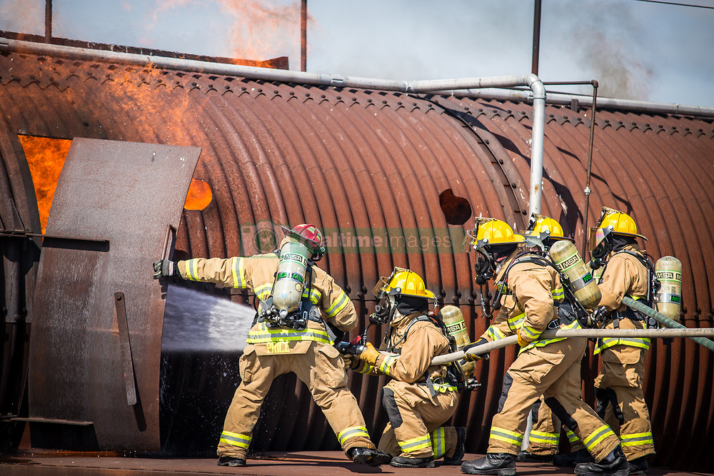 Firefighters assigned to the 139th Fire Emergency Services, Missouri Air National Guard, battle a simulated aircraft fire at Offutt Air Force Base, Neb., July 16, 2018. The civilians and airmen were conducting an aircraft live-fire exercise as part of their annual training. (U.S. Air National Guard photo by Staff Sgt. Patrick Evenson)
