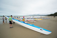 Boats Are Marshalled At The Finish, June 1, 2014 - OUTRIGGER : Hekili Great Barrier Reef Ocean Challenge, Cairns Airport Adventure Festival, Four Mile Beach, Port Douglas, Queensland, Australia. Credit: Lucas Wroe