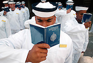 "AT ATTENTION: New inductees study the Naval Academy mission statement in their Reef Points handbook while being processed in with other enlisted sailors and students from the Naval Academy Preparatory School (NAPS) as they go through ""Induction Day Minus One"" at the United States Naval Academy in Annapolis on Tuesday June 29, 2004. They were processed in and issued gear at Alumni Hall at the United States Naval Academy. They were inducted into the academy the next day along with the rest of their class. (Alan Lessig/Navy Times)"