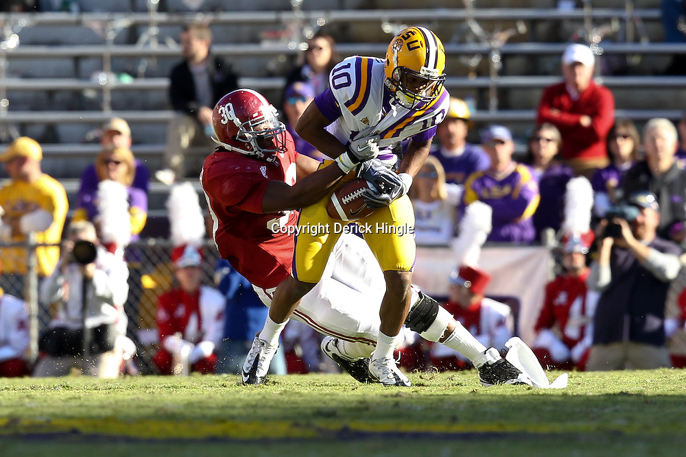 November 6, 2010; Baton Rouge, LA, USA; Alabama Crimson Tide linebacker Dont'a Hightower (30) tackles LSU Tigers wide receiver Russell Shepard (10) during the first half at Tiger Stadium. LSU defeated Alabama 24-21.  Mandatory Credit: Derick E. Hingle