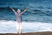 Senior woman welcomes a new day at the beach, Nauset, Beach, Cape Cod, MA