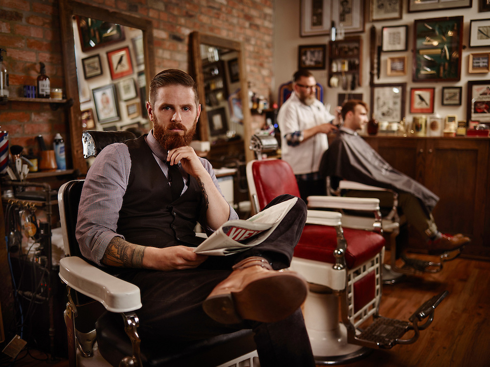 Barber sitting in his barber and cigar shop Shot on a PhaseOne IQ180 as a Environmental Portrait.