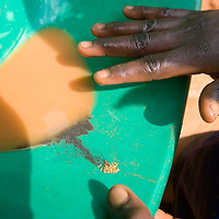 Local mining for gold in the village of Mongbwalu in Eastern Congo. A miner shows the gold he has just panned.