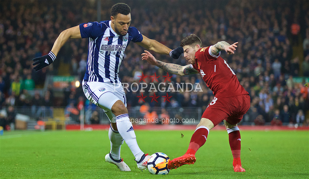 LIVERPOOL, ENGLAND - Sunday, January 14, 2018: West Bromwich Albion's Matt Phillips and Liverpool's Alberto Moreno during the FA Premier League match between Liverpool and Manchester City at Anfield. (Pic by David Rawcliffe/Propaganda)