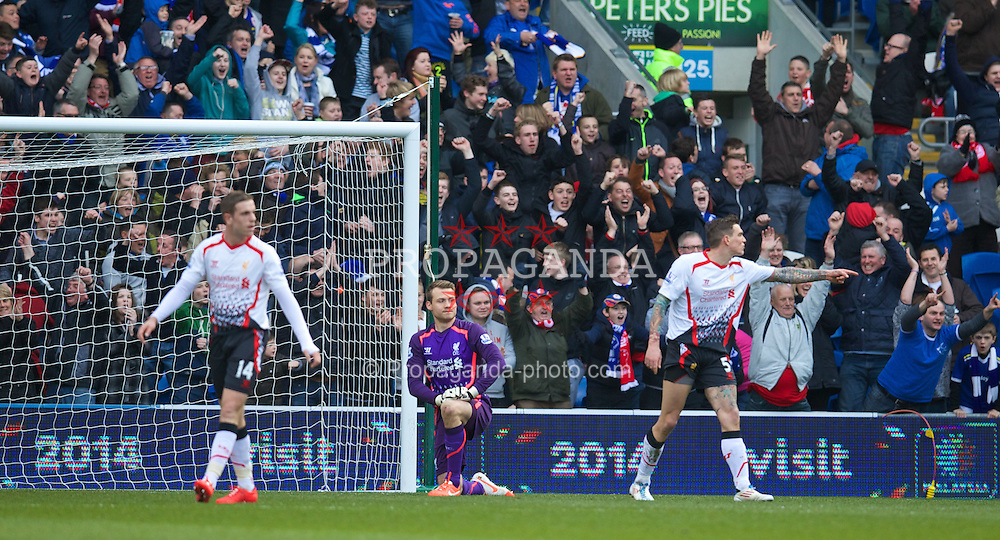 CARDIFF, WALES - Saturday, March 22, 2014: Liverpool's goalkeeper Simon Mignolet looks dejected as Cardiff City score the second goal during the Premiership match at the Cardiff City Stadium. (Pic by David Rawcliffe/Propaganda)