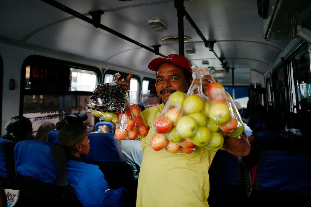 A man sells fruits on a bus in Caracas.