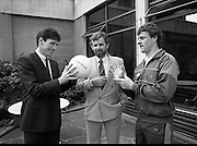 Frank Stapleton Testimonial.   (R77)..1988..25.04.1988..04.25.1988..25th April 1988..Today at the Guinness Reception Centre details of the testimonial match for Frank Stapleton were announced. Frank ,one of Ireland's greatest players,played 71 times for Ireland scoring 20 goals. During his illustrious career frank played for Arsenal, Manchester United and Ajax of Amsterdam. ..Picture shows Frank Stapleton,Tony Murtagh, Marketing Manager, Guinness and Kevin Moran displaying the ball to be used in the testimonial match.