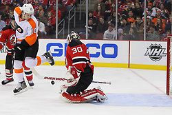 Jan 21; Newark, NJ, USA; New Jersey Devils goalie Martin Brodeur (30) makes a save through a screen by Philadelphia Flyers center Brayden Schenn (10) during the second period at the Prudential Center.