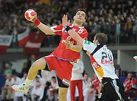 Handball EM Herren 2010 Vorrunde Deutschland - Polen 19.01.2010 Michat Jurecki (POL links) gegen Michael Haass (GER)