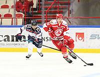 2018-11-14 | Ljungby, Sweden: Mörrums (13) Khalid Ibrahim and Troja-Ljungby (22) Carl-Johan Sjögren during the game between Troja Ljungby and Mörrums GoIS at Ljungby Arena ( Photo by: Fredrik Sten | Swe Press Photo )<br /> <br /> Keywords: Icehockey, Ljungby, HockeyEttan, Troja Ljungby, Mörrums GoIS, Ljungby Arena div1, division, troja, ljungby, mörrum, gois,