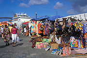 Crafts & souvenirs at street vendor stalls on boat day, ..with cruise ship in background; Otrobanda waterfront, ..Willemstad, Curacao, Netherlands Antilles.
