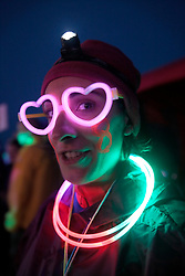 UK ENGLAND 29JUL17 - Volunteer Isabelle Husillos wears illuminated spectacles and parties at checkpoint 8 of the Trailwalker 2017 challenge across the South Downs, England.<br /> <br /> jre/Photo by Jiri Rezac<br /> <br /> © Jiri Rezac 2017