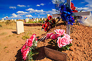 12 JULY 2012 - WINDOW ROCK, AZ:  A grave in the Navajo Veterans' Cemetery in Window Rock, AZ. More than 300 Navajo veterans are buried in the Veterans' Memorial Cemetery north of Window Rock, AZ, on BIA Highway 12. The cemetery is in the windswept high desert. Members of the military killed overseas are returned to the reservation for burial. The tribe has set aside 10 acres in Chinle, in the center of the reservation, but that site is awaiting funding from Washington.       PHOTO BY JACK KURTZ