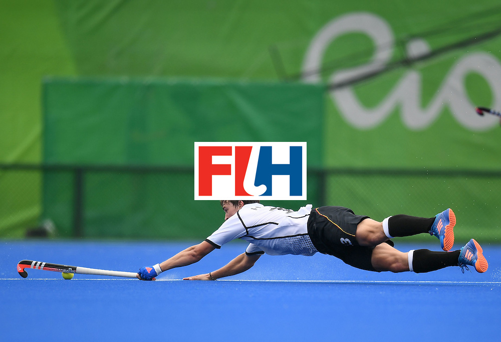 Germany's Linus Butt dives for the ball during the men's field hockey Germany vs India match of the Rio 2016 Olympics Games at the Olympic Hockey Centre in Rio de Janeiro on August, 8 2016. / AFP / MANAN VATSYAYANA        (Photo credit should read MANAN VATSYAYANA/AFP/Getty Images)