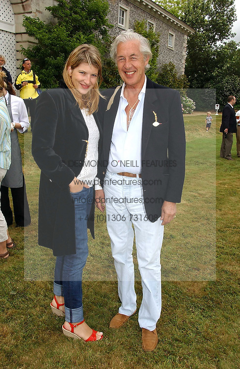 "MARTIN SUMMERS and his daughter TARA SUMMERS at the Goodwood Festival of Speed on 9th July 2006.  Cartier sponsored the ""Style Et Luxe' for vintage cars on the final day of this annual event at Goodwood House, West Sussex and hosted a lunch.<br />
