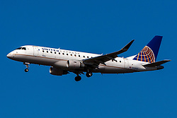 Embraer ERJ 170-200 LR (N103SY) operated by SkyWest Airlines for United Express on approach to San Francisco International Airport (KSFO), San Francisco, California, United States of America
