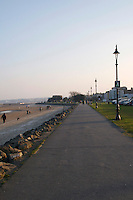 Walkway at Sandymount Strand in Dublin Ireland Martello Tower in the distance