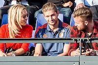 ROTTERDAM - Feyenoord - Olympiakos FC, Voetbal , Seizoen 2015/2016 , oefenwedstrijd , Stadion de Kuip , 01-07-2015 , Nieuwe aanwinst Jan-Arie van der Heijden (m) op de tribune met zijn vriendin Martine van Duijvenbode (l)