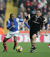 Photo: Lee Earle.<br /> Portsmouth v Charlton Athletic. The Barclays Premiership. 20/01/2007.Pompey's new signing Lauren (L) tracks Charlton's Matt Holland.