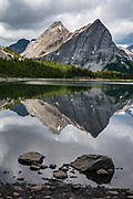 Lawson Lake reflects the limestone fangs of Mount Maude. Day hike from Forks Campground to North Kananaskis Pass (13 miles round trip/2700 ft) in Peter Lougheed Provincial Park, Kananaskis Country, Alberta, Canada.