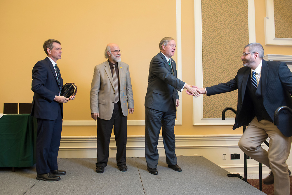 Presidential Teacher Award recipient Fabian Benencia accepts his award at Baker Ballroom on Oct. 31, 2018. Photo by Hannah Ruhoff