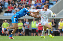 James Rodwell of England is tackled by Mattia Bellini of Italy - Photo mandatory by-line: Dougie Allward/JMP - Mobile: 07966 386802 - 11/07/2015 - SPORT - Rugby - Exeter - Sandy Park - European Grand Prix 7s