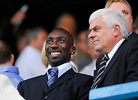 Photo: Leigh Quinnell.<br /> Queens Park Rangers v Cardiff City. Coca Cola Championship. 18/08/2007. New Cardiffs signing Jimmy Floyd Haslebaink enjoys the game with chairman Peter Ridsdale.