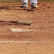 A baseball bat on the ground at home plate during the Bridgeport Bluefish V York Revolution, Atlantic League, Minor League ballgame at Harbor Yard Ballpark, Bridgeport, Connecticut, USA. Photo Tim Clayton