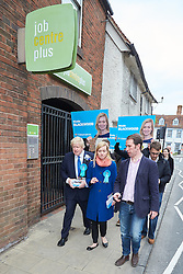 © Licensed to London News Pictures.  02/05/2015. ABINGDON, UK. Boris Johnson (left) walks past a job centre while campaigning in Abingdon with Nicola Blackwood (centre in blue coat) who is standing for re-election as MP for the Oxford West and Abingdon constituency.  Photo credit: Cliff Hide/LNP