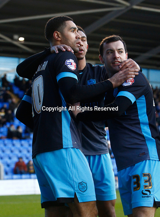30.01.2016. New Meadow, Shrewsbury, England. Emirates FA Cup 4th Round. Shrewsbury versus Sheffield Wednesday. Sheffield Wednesday midfielder Lewis McGugan is congratulated by team mates after scoring his team'ssecond goal.