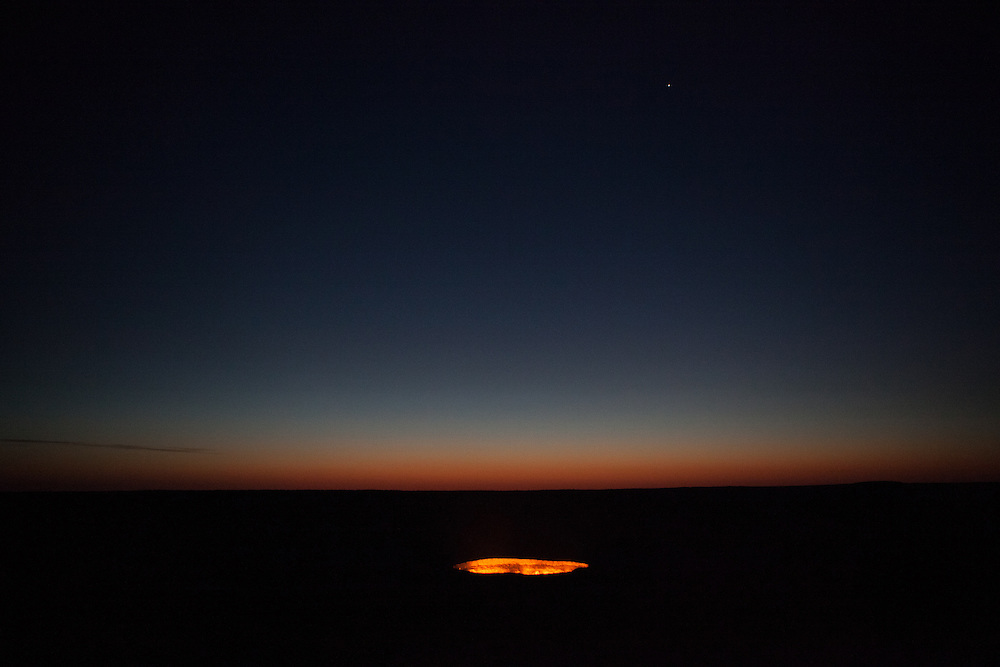 A distant view of the Darwaza gas crater at first light in the morning, Karakum Desert, Turkmenistan
