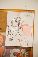 LaFollette, TN - Nov. 14, 2013: A child's drawing of Andrew Hamblin, pastor of the Tabernacle Church of God, hangs on the church's bulletin board. The church, whose congregation regularly handles snakes as part of services, had their snakes confiscated in early November by the Tennessee Wildlife Resources Agency for violating a Tennessee law against handling serpents in church. <br /> <br /> Photo by Shawn Poynter