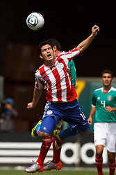 March 26, 2011; Oakland, CA, USA;  Paraguay midfielder Cristian Riveros (16) wins a head ball against Mexico during the first half at Oakland-Alameda County Coliseum.