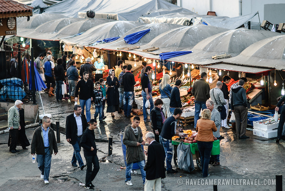 Customers in the early evening at the Karakoy Fish Market in Istanbul next to the Galata Bridge.