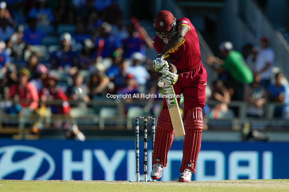 06.03.2015. Perth, Australia. ICC Cricket World Cup. India versus West Indies. Jason Holder misses the ball playing defensively.