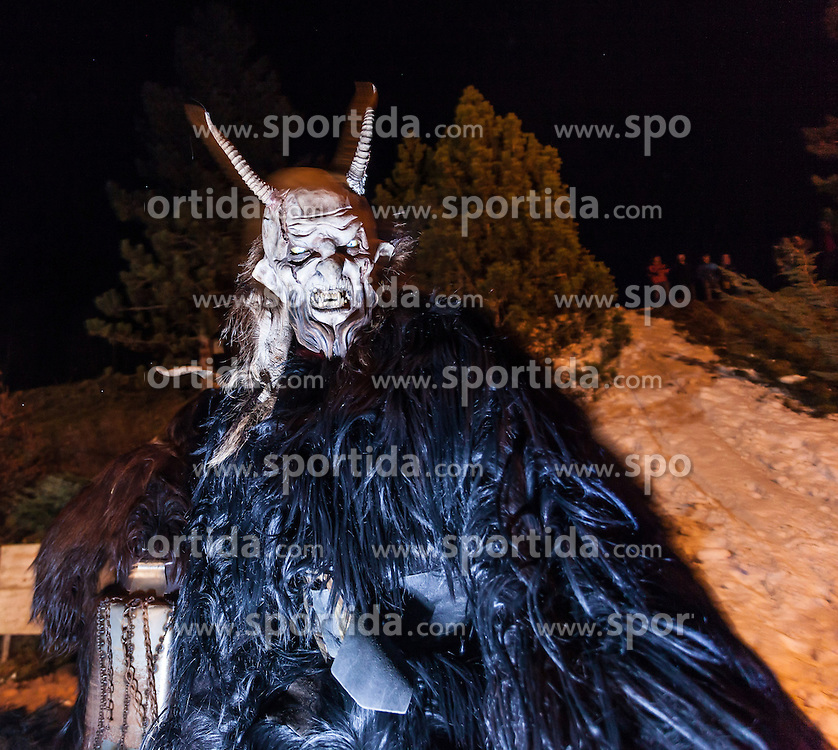 THEMENBILD - KRAMPUSLAUF, am Freitag, 30. November 2012, in Kaprun im Pinzgau. Der Krampus ist im ostalpenlaendischen Adventsbrauchtum eine Schreckgestalt, meist in Begleitung des Heiligen Nikolaus. Hier im Bild ein Krampus. // THEME PICTURE - Krampus, the mythical creature that, according to legend, accompanies Saint Nicholas during the festive season.  Instead of giving gifts to good children, he punishes the bad ones. In the picture is a Krampus. Image taken on 30.11.2012, Kaprun, Austria. EXPA Pictures © 2012, PhotoCredit: EXPA/ Juergen Feichter