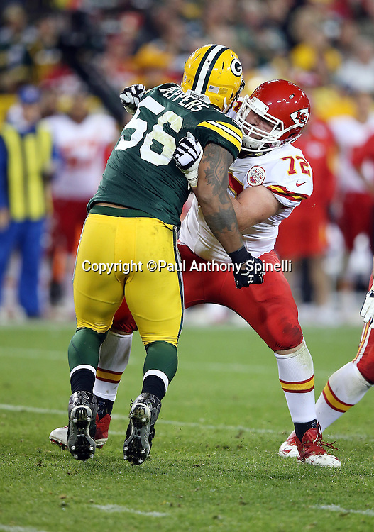 Green Bay Packers outside linebacker Julius Peppers (56) works his way around a block by Kansas City Chiefs tackle Eric Fisher (72) as he chases the action during the 2015 NFL week 3 regular season football game against the Kansas City Chiefs on Monday, Sept. 28, 2015 in Green Bay, Wis. The Packers won the game 38-28. (©Paul Anthony Spinelli)