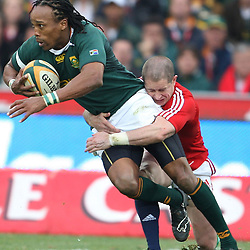 Odwa Ndungane of South Africa tackled by Shane Williams of the British and Irish Lions during the British and Irish Lions tour 2009
