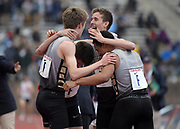 Apr 27, 2018; Philadelphia, PA, USA; Sean Dolan (center) celebrates with teammates Teddy Meredith, Amos Barnes Tim Dolan after running the 1,600m anchor leg on the Hopewell Valley distance medley relay that won the Championship of America race in a meet-record 9:57.55 during the 124th Penn Relays at Franklin Field.