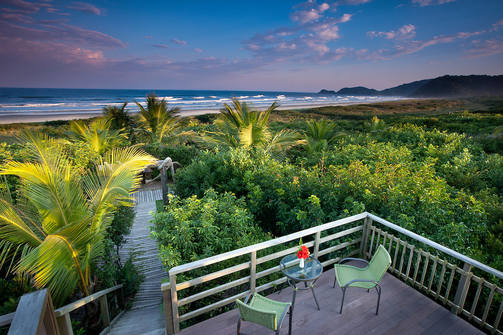 Deck overlooking the beach at Grajagan Surf Resort on Ilha do Mel, Brazil
